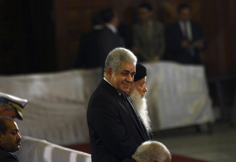 In this late Saturday, April 19, 2014 photo, Presidential candidate Hamdeen Sabahi attends Easter Eve service, as Egyptians celebrates Christianity's most joyous day, at St. Mark's Cathedral, in Cairo, Egypt. Sabahi, a former left-leaning presidential candidate, made formal his bid for office, submitting to the election commission just a little over 30,000 signatures Saturday endorsing his candidacy. (AP Photo/Ahmed Gomaa)