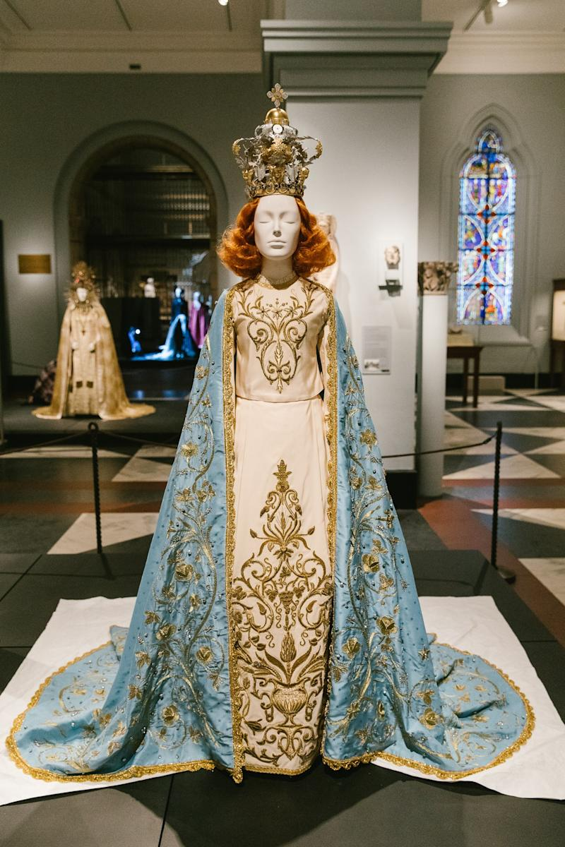 Riccardo Tisci (Italian, born 1974). The Poor Benedettine Cassinesi Nuns of Lecce (founded 1133) Statuary Vestment for the Madonna Delle Grazie, 2015; original design, 1950. Blue silk jacquard and gold metal passementerie, embroidered Swarovski crystals and gold metal thread and beads, ivory silk faille, embroidered polychrome crystals, gold paillettes, and metal studs.