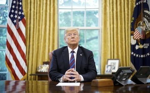 Donald Trump, the US president, in the Oval Office - Credit: MANDEL NGAN / AFP