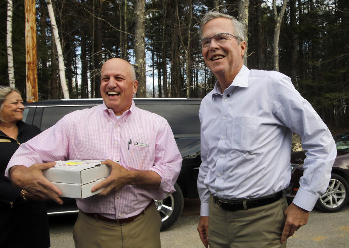 Former Florida Gov. Jeb Bush jokes with his host, Steve Duprey (left), at a Politics and Pie event hosted in Concord, N.H. in 2015. (Photo: Jim Cole/AP)