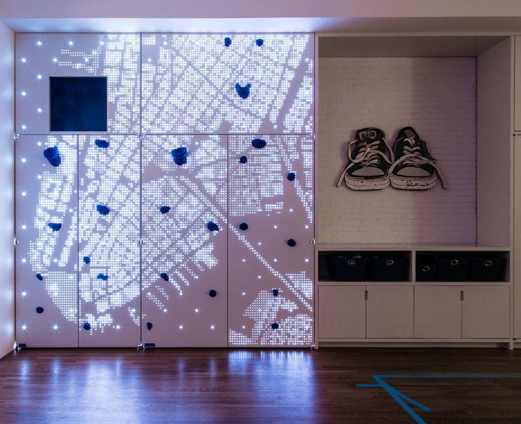 <p>Even the most basic of at-home climbing walls are incredible—add an light-up map of New York City as the backdrop and we're floored. It simply doesn't get more epic than this Studio DB-designed playroom. </p>