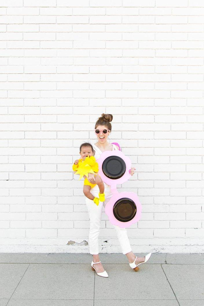 """<p>She is your sunshine, your only sunshine! Brighten up the Halloween festivities by dressing your daughter as a little ball of sunshine, with you as a coordinating pair of pretty pink shades.</p><p><strong>See more at <a href=""""https://studiodiy.com/diy-sunglasses-costume-sun-baby-costume/"""" rel=""""nofollow noopener"""" target=""""_blank"""" data-ylk=""""slk:Studio DIY!"""" class=""""link rapid-noclick-resp"""">Studio DIY!</a>. </strong></p><p><a class=""""link rapid-noclick-resp"""" href=""""https://www.amazon.com/Sweda-Plastic-Outdoor-Flexible-Children/dp/B08GG7TLNK/ref=sr_1_4?tag=syn-yahoo-20&ascsubtag=%5Bartid%7C2164.g.37079496%5Bsrc%7Cyahoo-us"""" rel=""""nofollow noopener"""" target=""""_blank"""" data-ylk=""""slk:SHOP FRISBEES"""">SHOP FRISBEES</a></p>"""