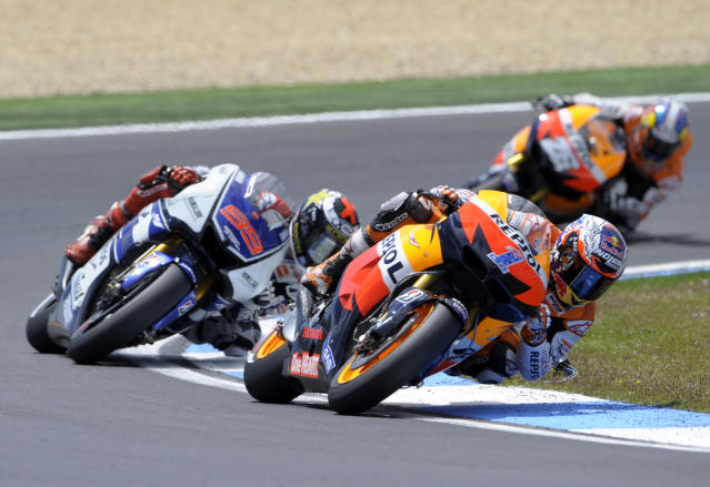 Repsol Honda team's Australian Casey Stoner rides ahead Yamaha Factory Racing team's Spanish Jorge Lorenzo and Repsol Honda team's Spanish Dani Pedrosa during the Moto GP race of the Portuguese Grand Prix in Estoril, outskirts of Lisbon, on May 6, 2012. Stoner won the race ahead of Lorenzo and Pedrosa. AFP PHOTO / MIGUEL RIOPAMIGUEL RIOPA/AFP/GettyImages