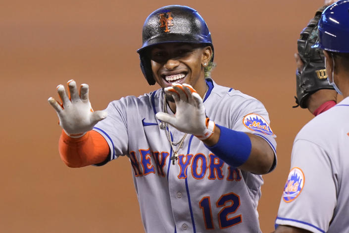 New York Mets' Francisco Lindor reacts after hitting a single during the first inning of a baseball game against the Miami Marlins, Saturday, May 22, 2021, in Miami. (AP Photo/Lynne Sladky)