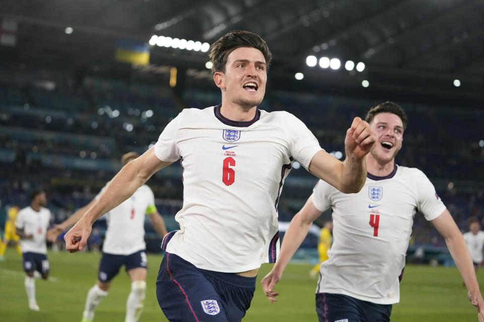 England's Harry Maguire, center, celebrates after scoring his side's second goal during the Euro 2020 soccer championship quarterfinal match between Ukraine and England at the Olympic stadium in Rome at the Olympic stadium in Rome, Italy, Saturday, July 3, 2021. (AP Photo/Alessandra Tarantino, Pool)