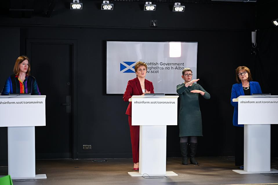 First Minister Nicola Sturgeon (centre) speaking at a coronavirus briefing at St Andrews House in Edinburgh with Scotland's Chief Medical Officer Dr Catherine Calderwood (left) and Health Secretary Jeane Freeman (right).