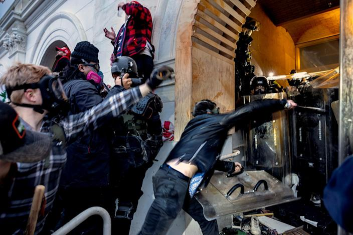 Trump supporters clash with police and security forces as people try to storm the Capitol on Jan. 6, 2021. (Brent Stirton / Getty Images file)