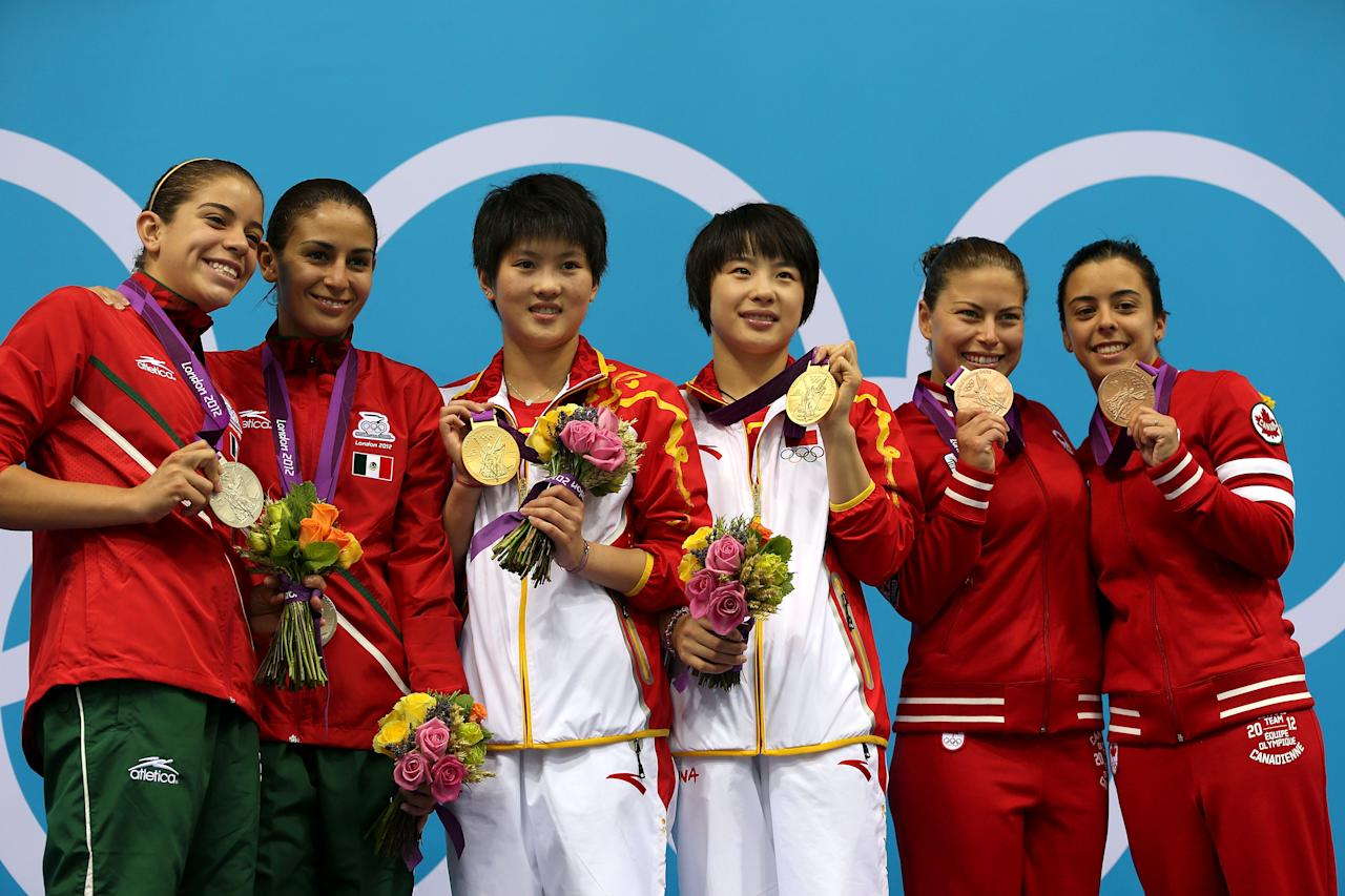 LONDON, ENGLAND - JULY 31: Silver medallists Alejandra Orozco Loza and Paola Espinosa of Mexico, gold medallists Chen Roulinand Hao Wang of China and bronze medallists Roseline Filion and Meaghan Benfeito of Canada pose on the podium during the medal ceremony for the Women's Synchronised 10 Platform Diving on Day 4 of the London 2012 Olympic Games at the Aquatics Centre on July 31, 2012 in London, England. (Photo by Clive Rose/Getty Images)