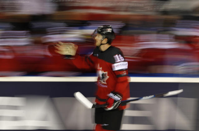 Canada's Jared McCann, right, celebrates after scoring his sides third goal during the Ice Hockey World Championships group A match between Canada and the United States at the Steel Arena in Kosice, Slovakia, Tuesday, May 21, 2019. (AP Photo/Petr David Josek)