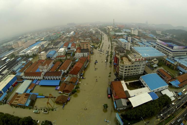 This aeriel photo shows heavily flooded streets after Typhoon Fitow swept through Yuyao, in China's Zhejiang province, on October 9, 2013