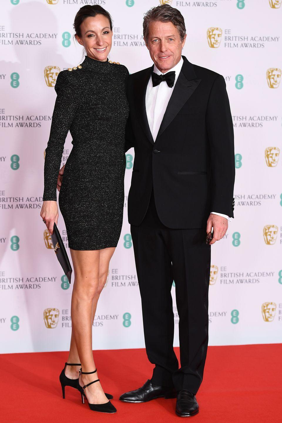<p>Hugh Grant and wife Anna Eberstein posed together on the red carpet. </p>