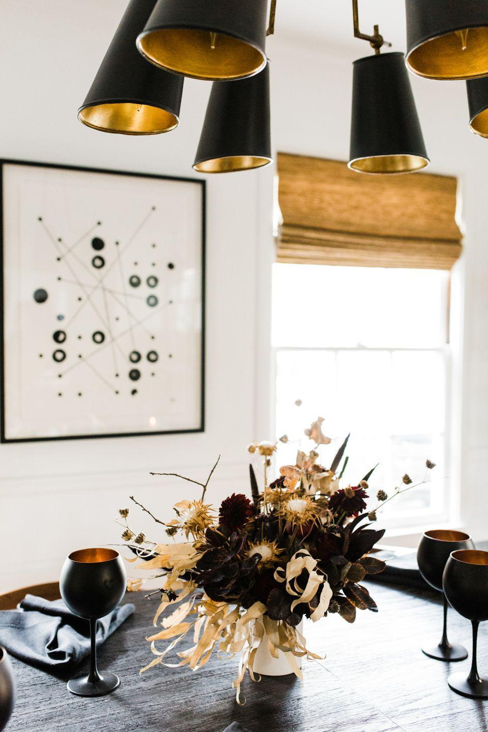 "<p>Paired with inky black stemware and napkins, this moody floral arrangement by <a href=""https://cheetahisthenewblack.com/living/lifestyle/grown-up-halloween-entertaining/"" rel=""nofollow noopener"" target=""_blank"" data-ylk=""slk:Cheetah Is the New Black"" class=""link rapid-noclick-resp"">Cheetah Is the New Black </a>sets the scene for an elegant, grown-up Halloween dinner party. </p><p><a class=""link rapid-noclick-resp"" href=""https://www.amazon.com/Black-Patterned-Wine-Glasses-FE13697905/dp/B00XGDSBHC/ref=sr_1_1?dchild=1&keywords=black+goblets&qid=1602268314&s=home-garden&sr=1-1&tag=syn-yahoo-20&ascsubtag=%5Bartid%7C10057.g.2554%5Bsrc%7Cyahoo-us"" rel=""nofollow noopener"" target=""_blank"" data-ylk=""slk:BUY NOW"">BUY NOW</a> <strong><em>Black Goblets, $27</em></strong></p>"