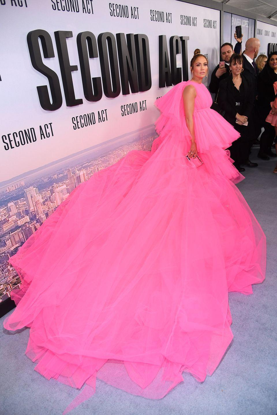 <p>Quite literally one of the biggest red-carpet moments of the year came courtesy of Jennifer Lopez, who attended the New York premiere of Second Act in this huge pink Giambattista Valli gown, which was from the designer's most recent couture collection. The dress immediately blew up on social media thanks to its dramatic volume and neon hue. In fact, the gown was so large that she had to be transported to the venue in a private van. </p>
