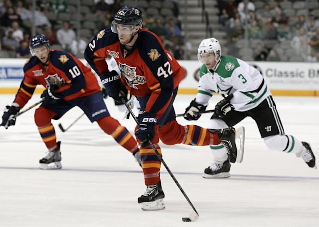 Florida Panthers' Quinton Howden (42) attempts a shot as teammate Joey Crabb (10) and Dallas Stars' Stephane Robidas (3) watch in the second period of a preseason NHL hockey game on Wednesday, Sept. 18, 2013, in Dallas. (AP Photo/tony gutierrez)