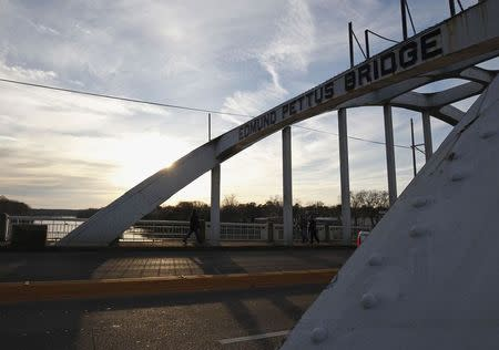 The sun sets along the Edmund Pettus Bridge, in Selma, Alabama March 6, 2015. U.S. President Barack Obama will deliver remarks on the bridge on Saturday to commemorate the 50th anniversary of the Selma to Montgomery civil rights marches. REUTERS/Tami Chappell
