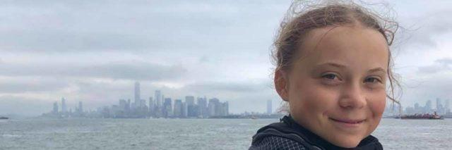 Greta Thunberg with New York City landscape in the background