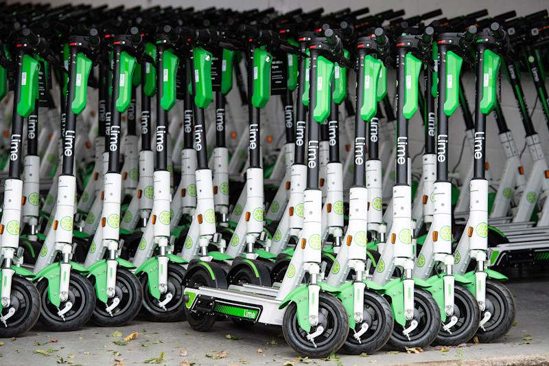 EDITORIAL USE ONLY A group of parked e-scooters as Lime launches the UK's first, full-scale e-scooter service in Milton Keynes with 500 scooters deployed, as part of a nationwide launch this year.