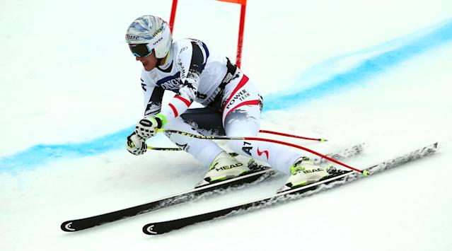 Austria's Matthias Mayer speeds down the slope on his way to take the third place at an alpine ski, men's World Cup downhill, in Kvitfjell, Norway, Saturday, March 1, 2014. (AP Photo/Alessandro Trovati)
