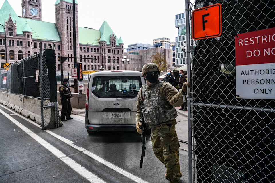 National Guards and other Law enforcement officers stand guard outside the Hennepin County Government Centre in Minneapolis (AFP via Getty Images)