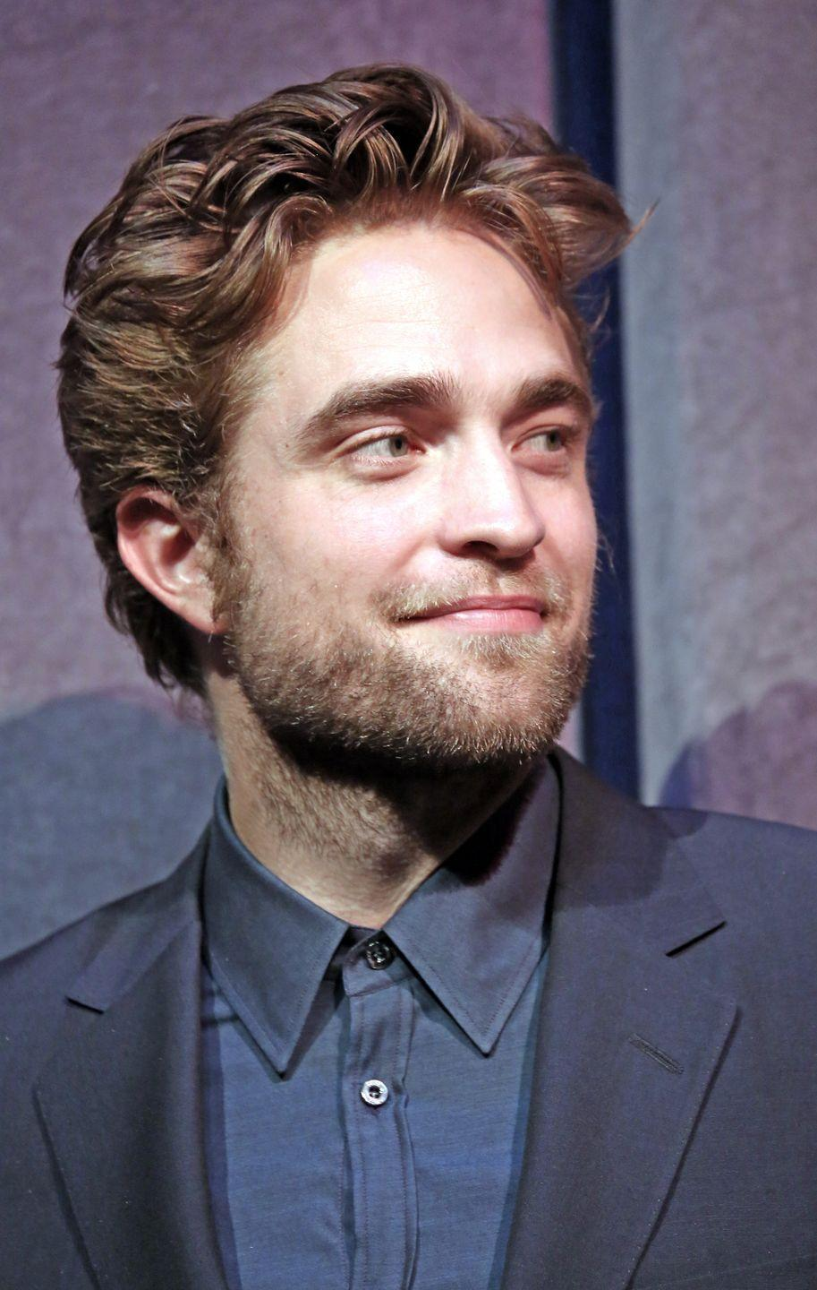 """<p>Pattinson is a master of this kind of two-texture vibe that a lot of hair textures and styles can pull off. The top is pieced and tousled, but the sides are pushed back. </p><p>This is where something DeZarate calls """"product cocktailing"""" comes into use: You use different products for different spots on your head. This is useful for this particular style and more generally for people with differently textured hair on different parts of their head. </p><p>On top, use something with a little shine and movable hold, like creams and those gel-serums. On the sides, you can use a thicker product, like<a href=""""https://www.amazon.com/Co-Motorcycle-Flexible-Gel-Fl/dp/B01B8DBYOS?tag=syn-yahoo-20&ascsubtag=%5Bartid%7C2139.g.33898672%5Bsrc%7Cyahoo-us"""" rel=""""nofollow noopener"""" target=""""_blank"""" data-ylk=""""slk:R+Co's flexible gel"""" class=""""link rapid-noclick-resp""""> R+Co's flexible gel</a>. """"Layering these two products gives you the hold you want while still staying flexible,"""" she says. </p>"""