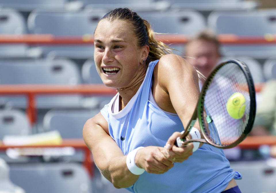 FILE - Aryna Sabalenka, of Belarus, returns to compatriot Victoria Azarenka during quarterfinal play at the women's National Bank Open tennis tournament in Montreal, in this Friday, Aug. 13, 2021, file photo. Sabalenka is seeded for the U.S. Open, the year's last Grand Slam tennis tournament. Play in the main draw begins in New York on Monday, Aug. 30. (Paul Chiasson/The Canadian Press via AP, File)