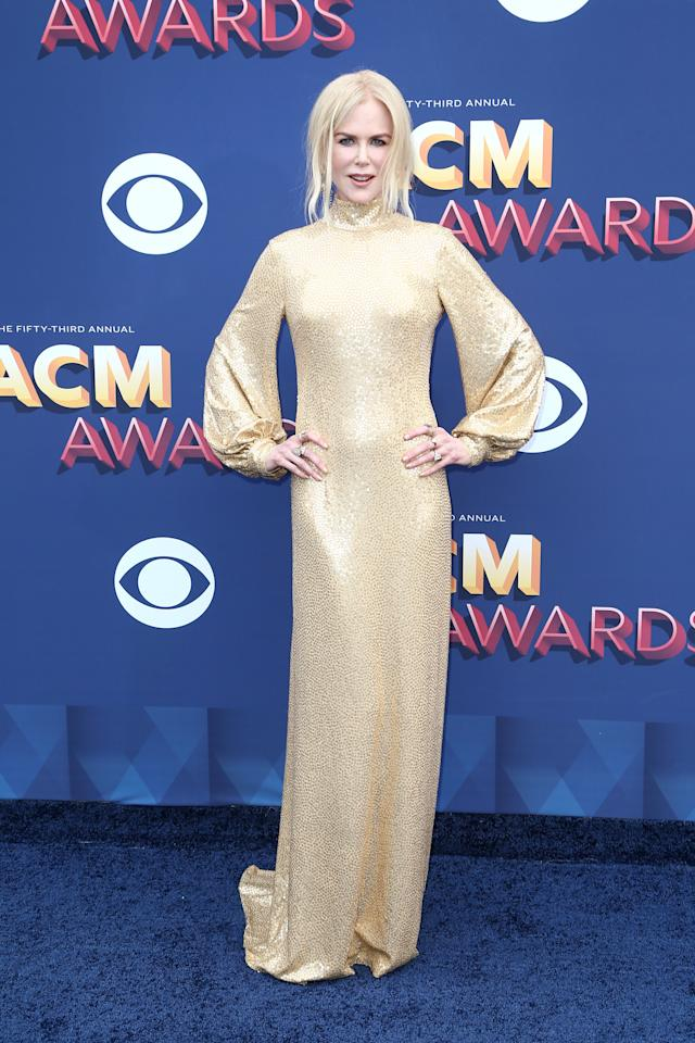 """<p>Nicole Kidman took a break from filming the second season of the hit HBO miniseries """"Big Little Lies"""" to support her country singer husband, Keith Urban. Kidman's gold Michael Kors gown must have channelled a win for Urban. The singer took home four awards including Best Vocal Event of the Year alongside Carrie Underwood. </p>"""