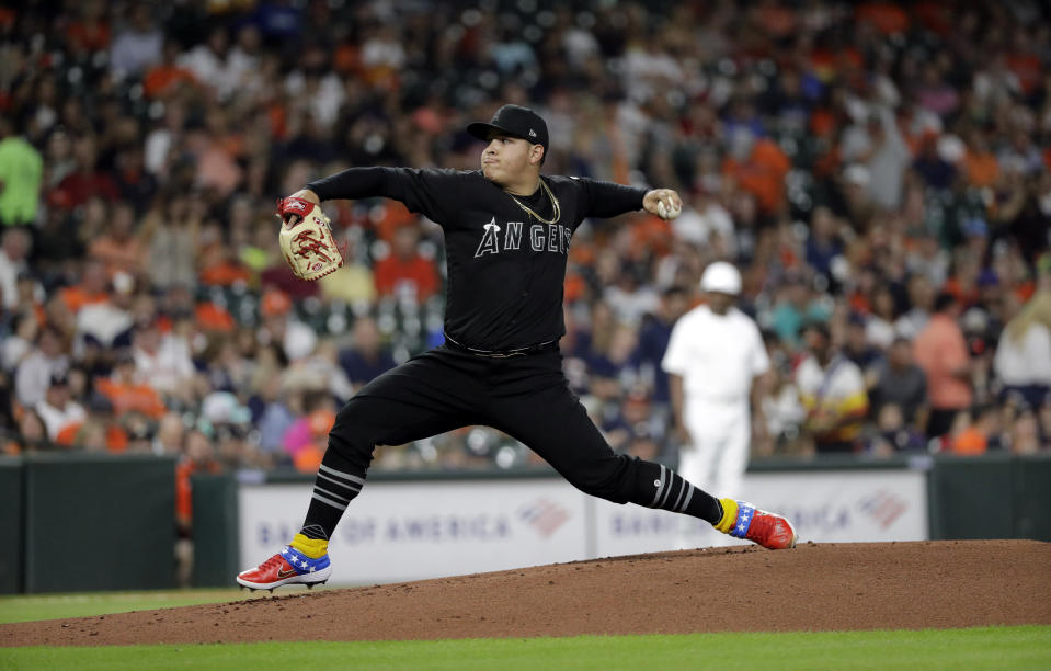 Los Angeles Angels starting pitcher Jose Suarez throws against the Houston Astros during the first inning of a baseball game Friday, Aug. 23, 2019, in Houston. (AP Photo/David J. Phillip)