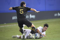 Los Angeles FC defender Dejan Jakovic (5) and LA Galaxy forward Cristian Pavon compete for the ball during the first half of an MLS soccer match Saturday, July 18, 2020, in Kissimmee, Fla. (AP Photo/Phelan M. Ebenhack)