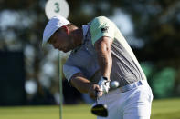 Bryson DeChambeau hits his second tee shot after his first was lost off the third fairway during the second round of the Masters golf tournament Friday, Nov. 13, 2020, in Augusta, Ga. (AP Photo/David J. Phillip)