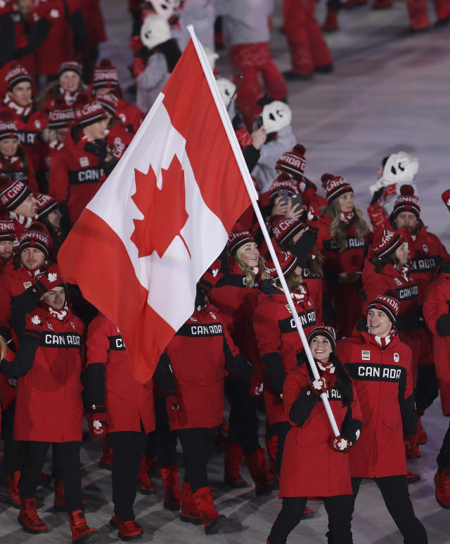 <p>As the most decorated duo in the history of Canadian ice dancing, Tessa and Scott were given the honor of carrying out their country's flag for their final Olympic Games. (AP) </p>