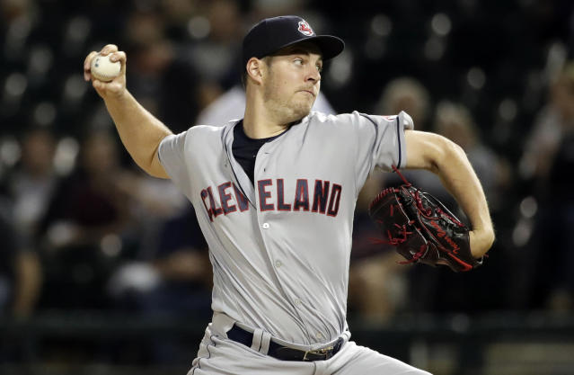 FILE - In this Sept. 25, 2018, file photo, Cleveland Indians starting pitcher Trevor Bauer throws against the Chicago White Sox during the first inning of a baseball game in Chicago. Bauer has gone to salary arbitration with the Indians for the second straight year. After winning last year's hearing, Bauer asked for $13 million on Friday, Feb. 8, 2019, and the Indians argued for $11 million. (AP Photo/Nam Y. Huh, File)