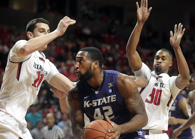 Kansas State's Thomas Gipson (42) is defended by Texas Tech's Dejan Kravic (11) and Jaye Crockett (30) during an NCAA college basketball game in Lubbock, Texas, Tuesday, Feb, 25, 2014. (AP Photo/Lubbock Avalanche-Journal, Stephen Spillman)