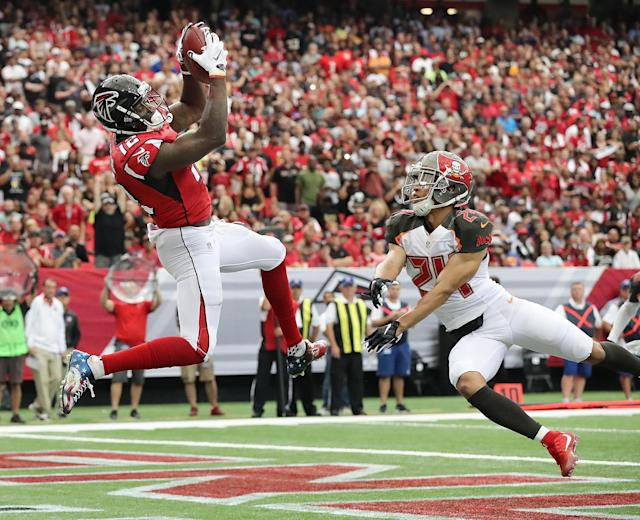 <p>Atlanta Falcons wide receiver Mohamed Sanu (12) scores a touchdown against Tampa Bay Buccaneers defensive back Brent Grimes (24) during the first half of an NFL football game, Sunday, Sept. 11, 2016, in Atlanta. (Curtis Compton/Atlanta Journal-Constitution via AP) </p>