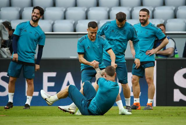 Soccer Football - Champions League - Real Madrid Training - Allianz Arena, Munich, Germany - April 24, 2018 Real Madrid's Lucas Vazquez and Sergio Ramos during training REUTERS/Michael Dalder
