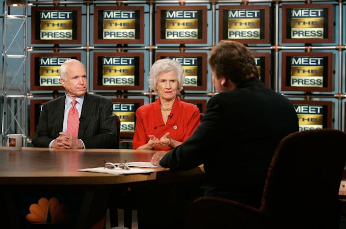 """McCain and his mother, Roberta McCain, are interviewed by moderator Tim Russert during a taping for a broadcast on the """"Meet the Press"""" website at the NBC Studios on May 13, 2007."""