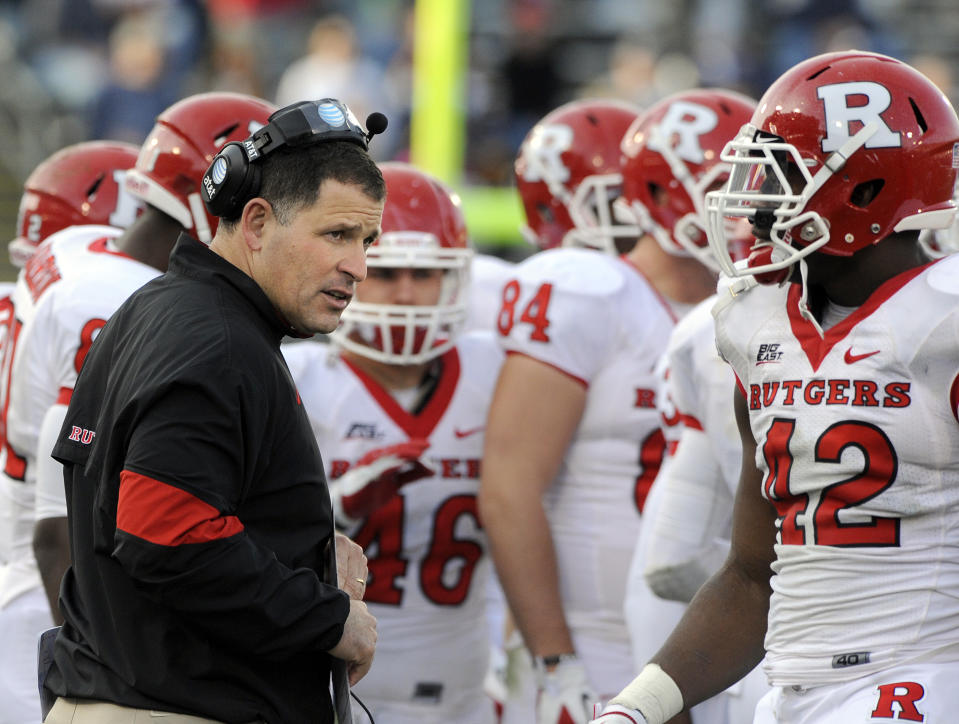 Rutgers coach Greg Schiano speaks with players during the second half of a game against Connecticut in 2011. (AP)