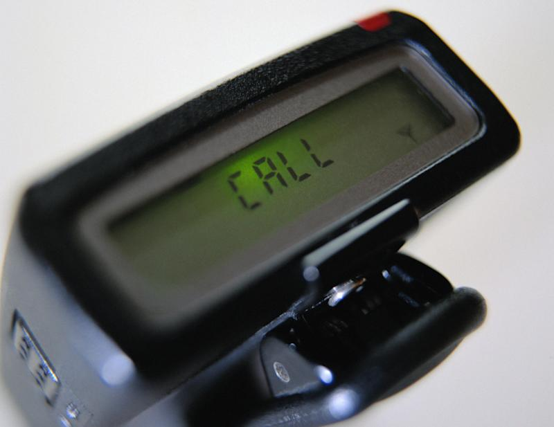 """A pager with a message that says """"Call."""""""