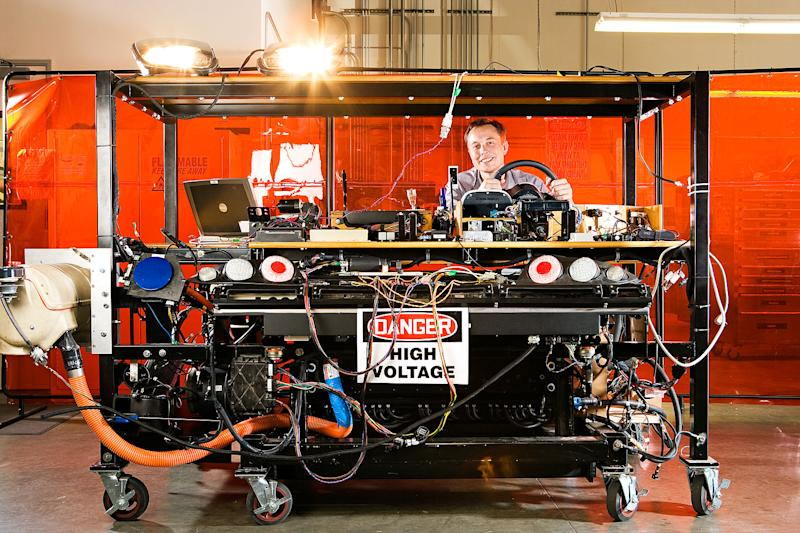 </a> Musk, pictured in a vehicle electronics simulator referred to as the