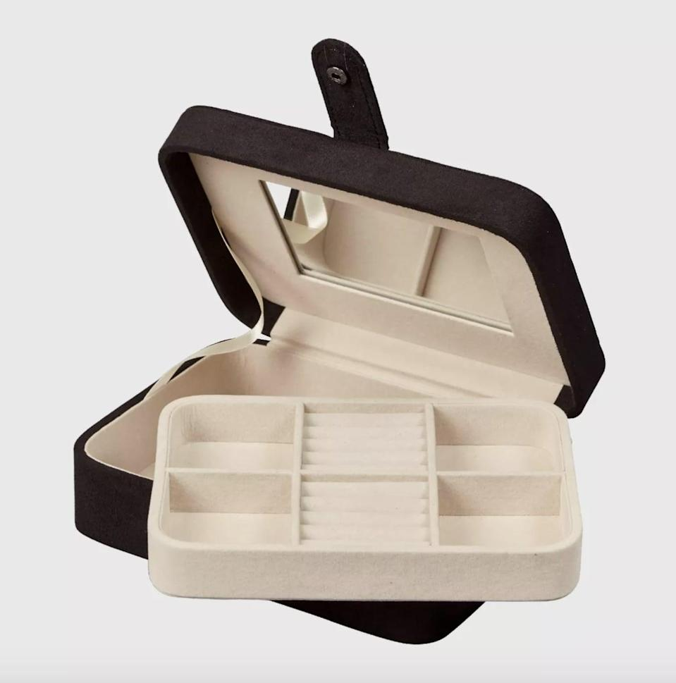 <p>The <span>Mele &amp; Co. Giana Women's Plush Fabric Jewelry Box with Lift Out Tray-Black</span> ($33) will protect and cushion your pieces.</p>