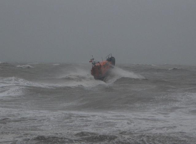 An RNLI boat going to sea off the coast of Hastings to search for a missing surfer, who was later found safe (Picture: PA)