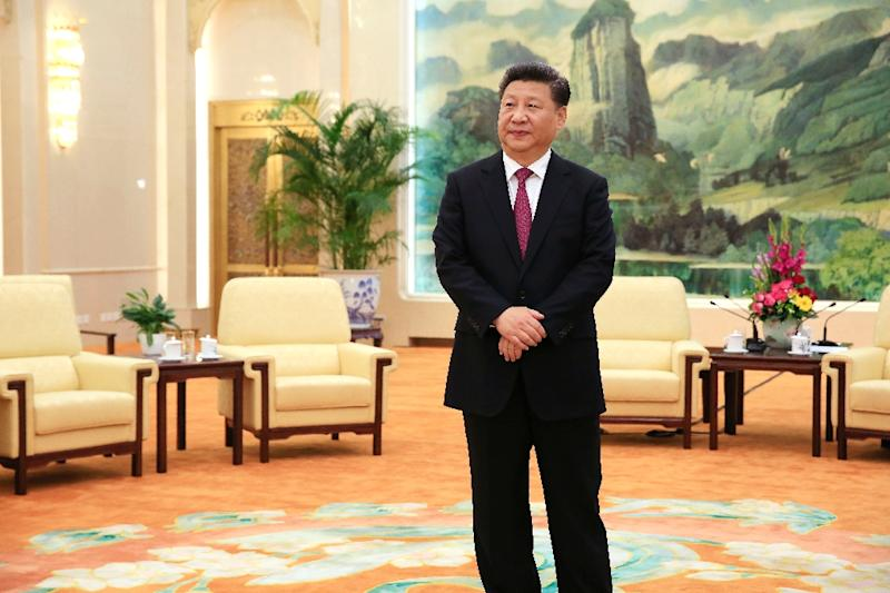 More time as president could allow Xi Jinping to follow through on long-promised reforms and bolster his more assertive foreign policy in the South China Sea, experts say (AFP Photo/How Hwee Young)