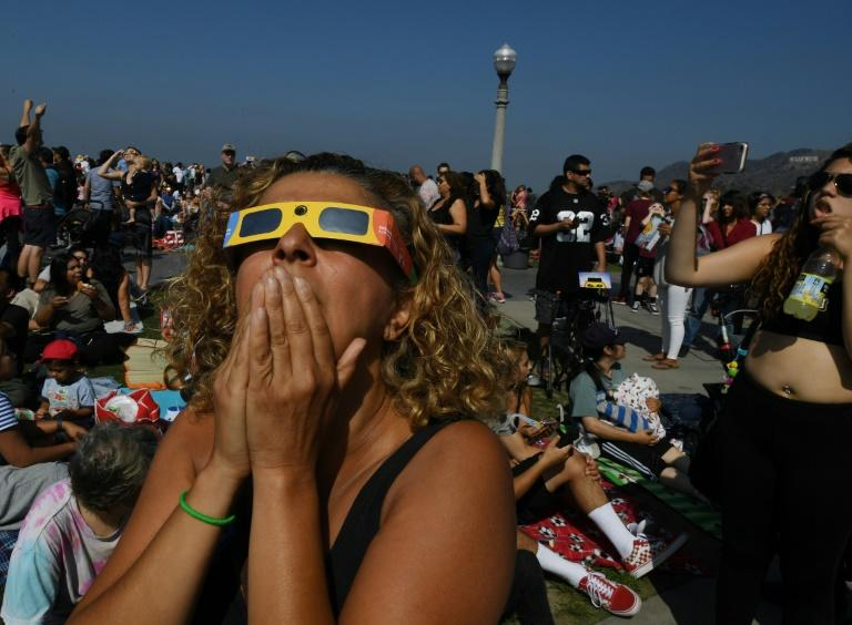 Emotional stargazers watched the celestial show unfold from the Griffith Observatory in Los Angeles