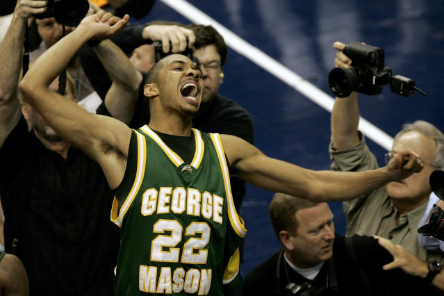 FILE - In this Monday, March 26, 2006, file photo, George Mason's Lamar Butler (22) reacts after beating Connecticut 86-84 in overtime during the fourth round game of the NCAA basketball tournament in Washington. (AP Photo/Susan Walsh, File)