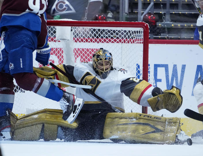 Vegas Golden Knights goaltender Marc-Andre Fleury (29) makes a save against the Colorado Avalanche during the first period in Game 2 of an NHL hockey Stanley Cup second-round playoff series Wednesday, June 2, 2021, in Denver. (AP Photo/Jack Dempsey)