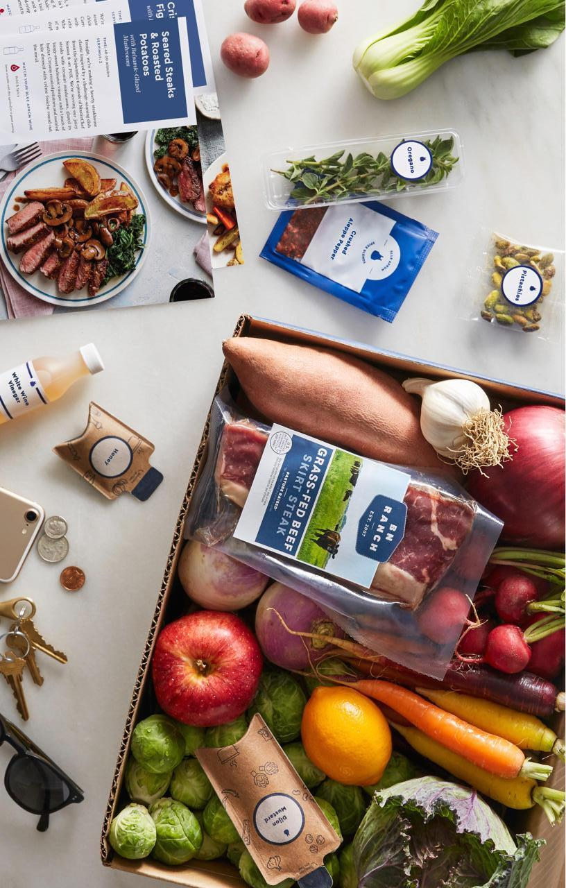 """<strong><h3><a href=""""https://www.blueapron.com/"""" rel=""""nofollow noopener"""" target=""""_blank"""" data-ylk=""""slk:Blue Apron"""" class=""""link rapid-noclick-resp"""">Blue Apron</a></h3></strong><br><strong>The elevator pitch:</strong> """"Makes cooking fun and easy. We'll provide you with all the ingredients that you need to make a delicious meal in exactly the right proportions.""""<br><br><strong>Cost:</strong> 2-person plan supplies 2-4 recipes per week at $9.99 per serving. The Family Plan supplies 2-4 recipes per week (serving 4) for a total of either $71.92 or $119.84 (ranging from $8.99 to $7.49 per serving).<br><br><strong>Delivery schedule: </strong>7 days a week in most locations.<br><br><strong>What you get: </strong>A flexible subscription for farm-fresh dinner with seasonal produce and spot-on proportions (no leftover food-waste here). Blue Apron also offers a wine-pairing membership to complement your selected dishes (if you so choose).<br><br><strong>Cooking required? </strong>Yes. You get pre-measured ingredients with recipes, minus salt, pepper, and olive oil.<br><br><strong>Great for: </strong>Those looking to share in a straightforward food-delivery lifestyle with fresh food and wine."""