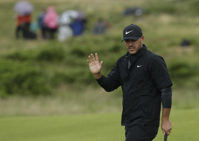 Brooks Koepka of the United States acknowledges the crowd after putting on the 9th green during the first round of the British Open Golf Championships at Royal Portrush in Northern Ireland, Thursday, July 18, 2019.(AP Photo/Matt Dunham)