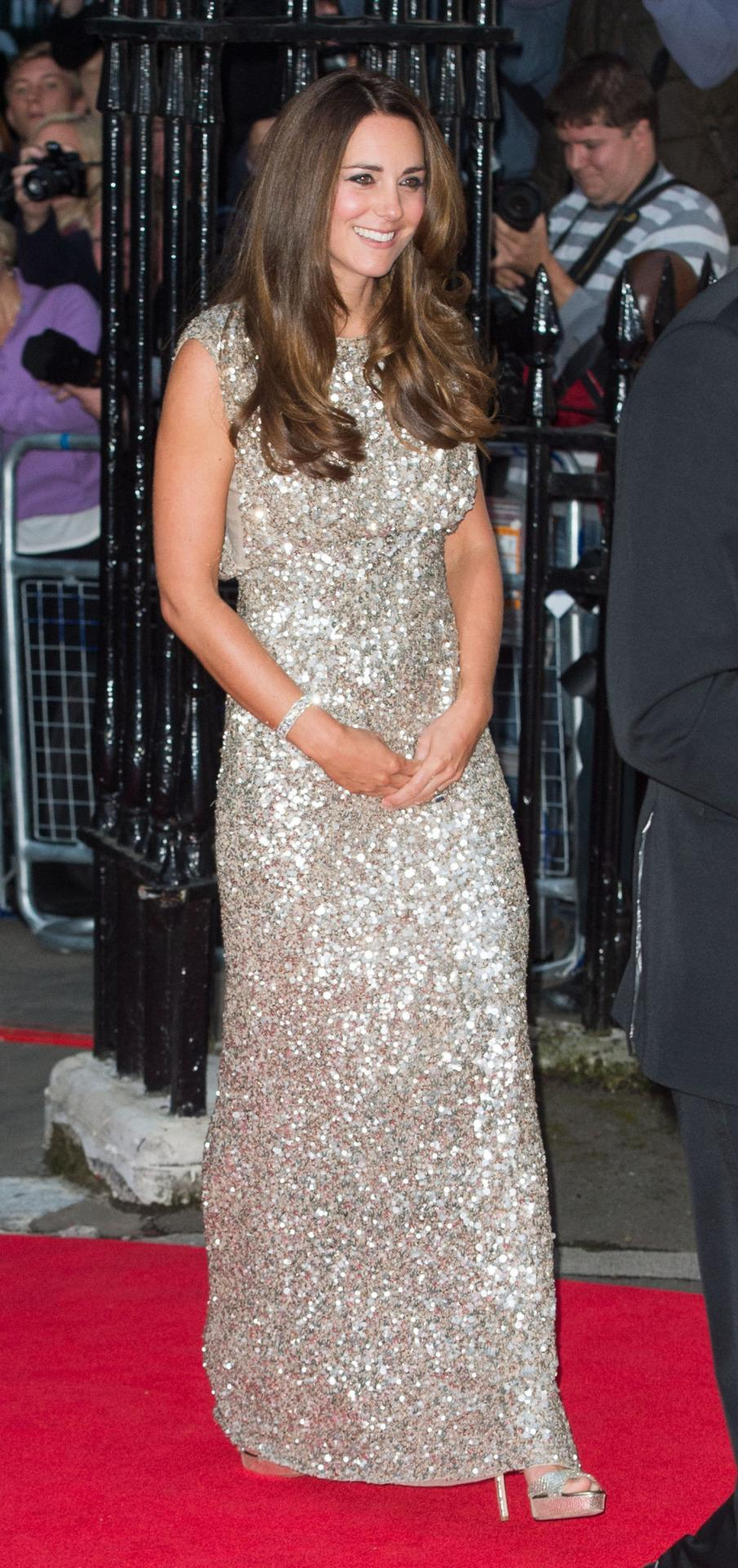 <p>Kate attended an awards ceremony in a glittering gold Jenny Packham gown. She accessorised with matching shiny Jimmy Choo sandals. </p><p><i>[Photo: PA]</i></p>
