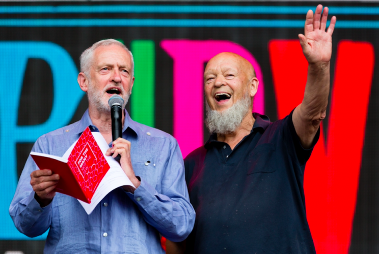 Jeremy Corbyn and Michael Eavis drew rapturous applause at Glastonbury (REX)