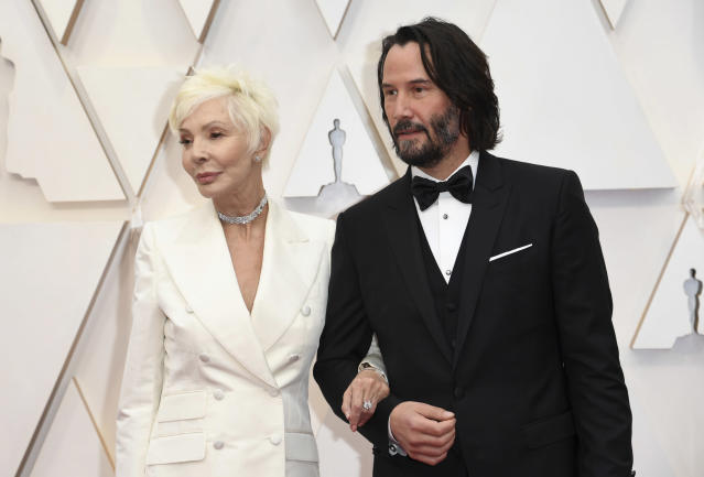 Keanu Reeves and his mother Patricia Taylor arrive at the Oscars on Sunday. (Richard Shotwell/Invision/AP)