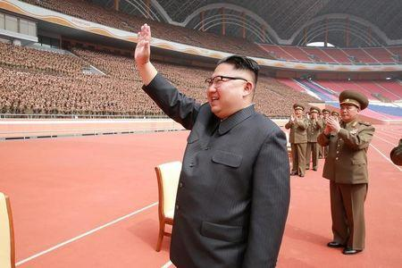 North Korean leader Kim Jong Un waves to the members of the Korean People's Army